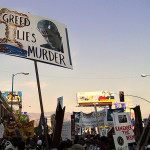 Greed_Lies_Murder_Protest_sign