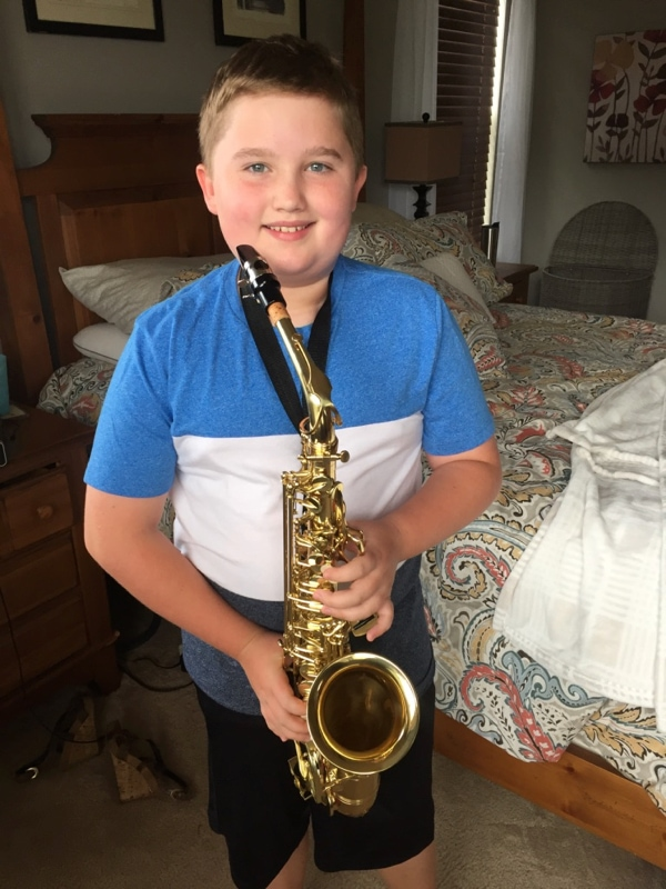 Evan starting his saxophone