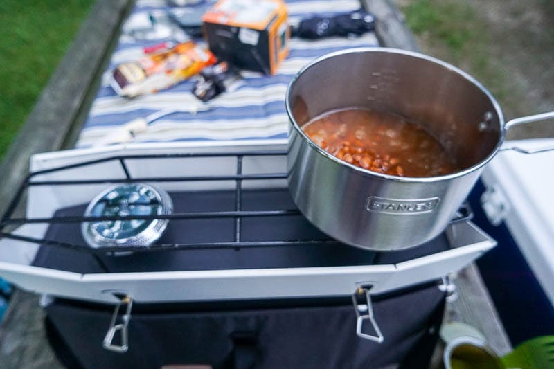 Cooking baked beans on a camp stove