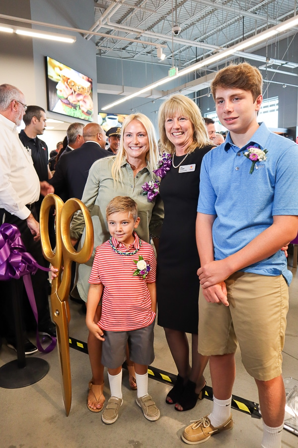 Store Manager Lisa Schepers and family cut the ribbon!