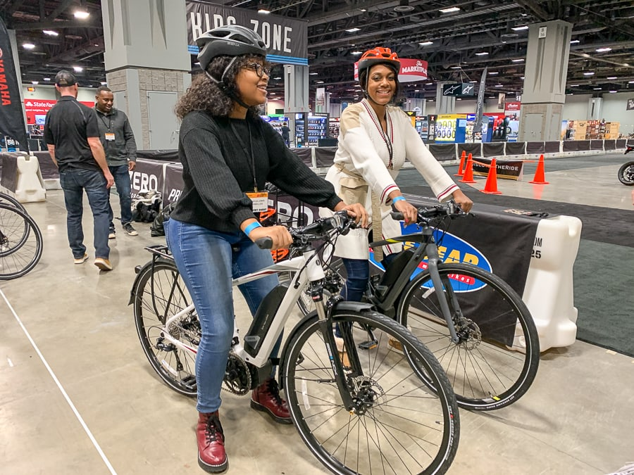 Crystal Lewis and her daughter riding the e-bikes at Discover the Ride.