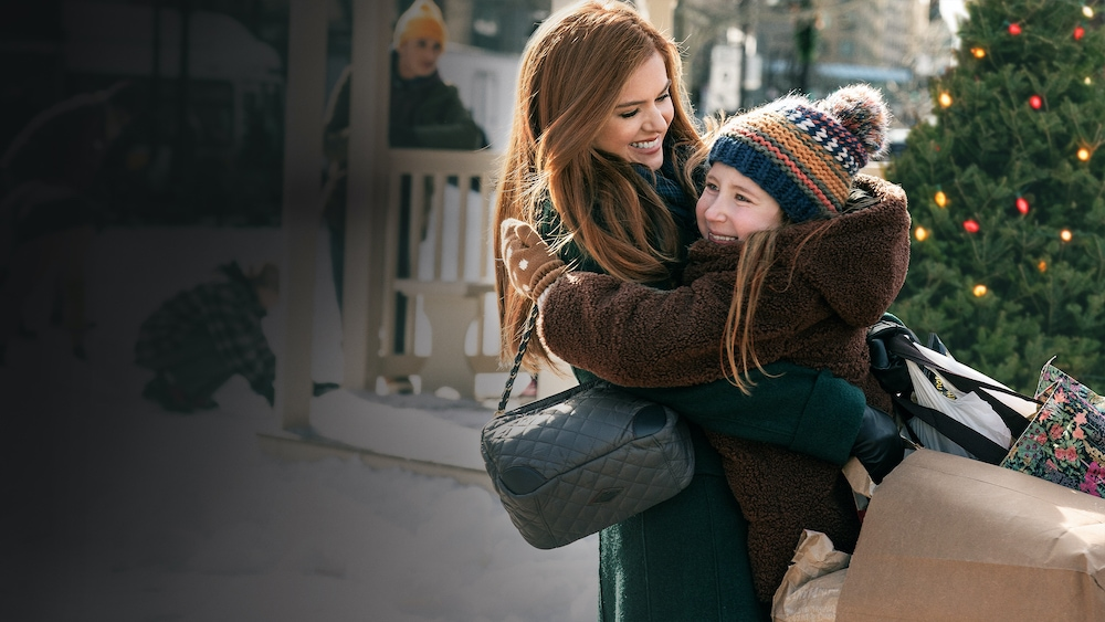 Isla Fisher as Mackenzie and Willa Skye as Mia in GODMOTHERED, exclusively on Disney+.