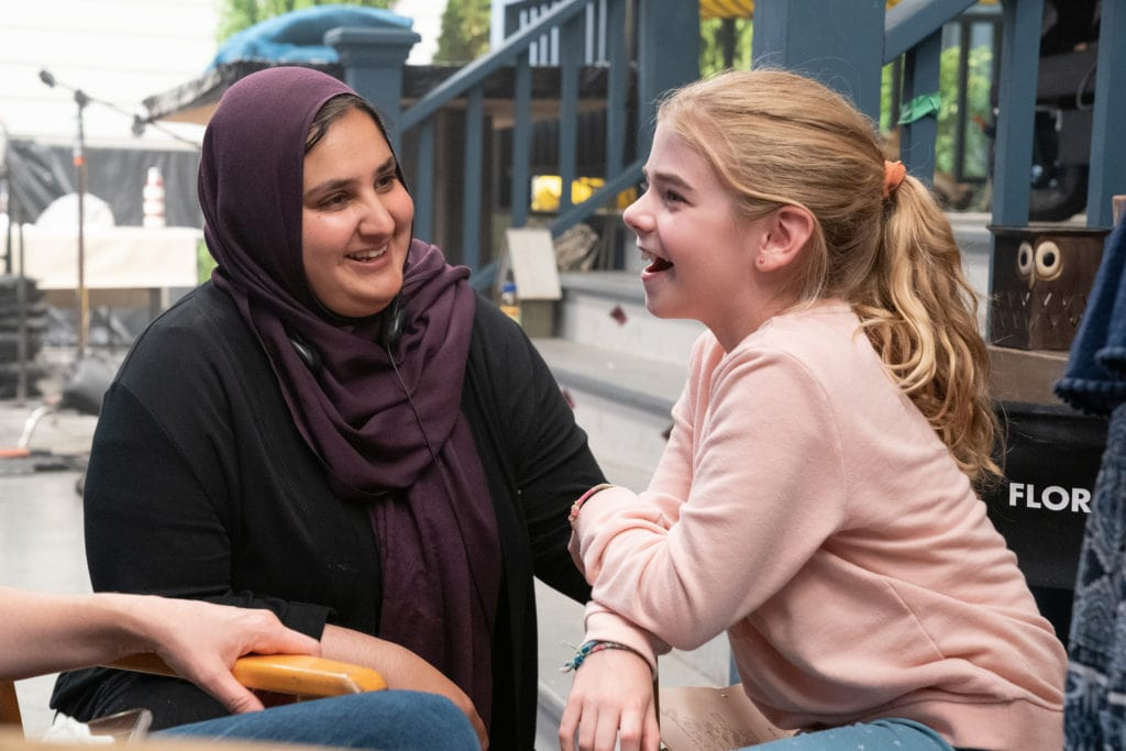 Director Lena Khan and Matilda Lawler behind the scenes of FLORA & ULYSSES, exclusively on Disney+.